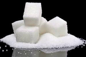 Сахар на черном фоне